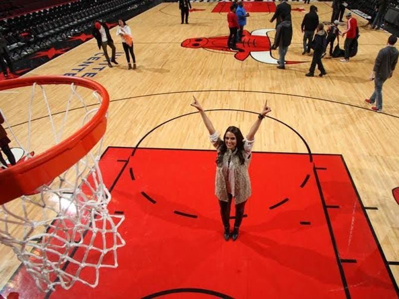 Neha Dhupia is can't to hide her excitement at the NBA Chicago Bull's court.
