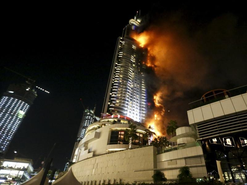 The Address Downtown hotel, which is a few blocks from the iconic Burj Khalifa, the world's tallest tower, was engulfed in flames across several floors as sirens wailed and helicopters hovered overhead. (REUTERS)