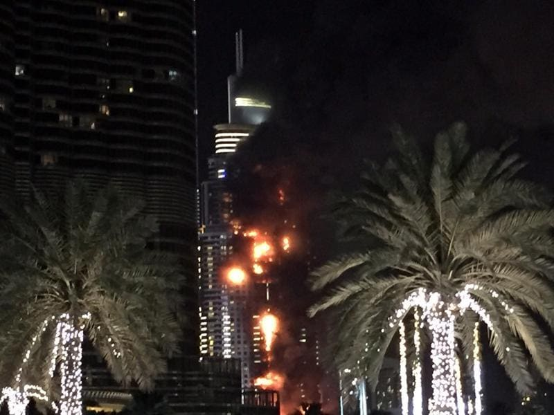 Dubai's police chief said all the residents of the five star hotel had been evacuated from the scene of the blaze, which had still not been extinguished some three hours after it broke out. (AP)