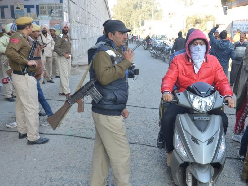 Policemen patrol a street in Punjab's Pathankot after terrorists attacked an air force base.  (Sameer Sehgal/HT)