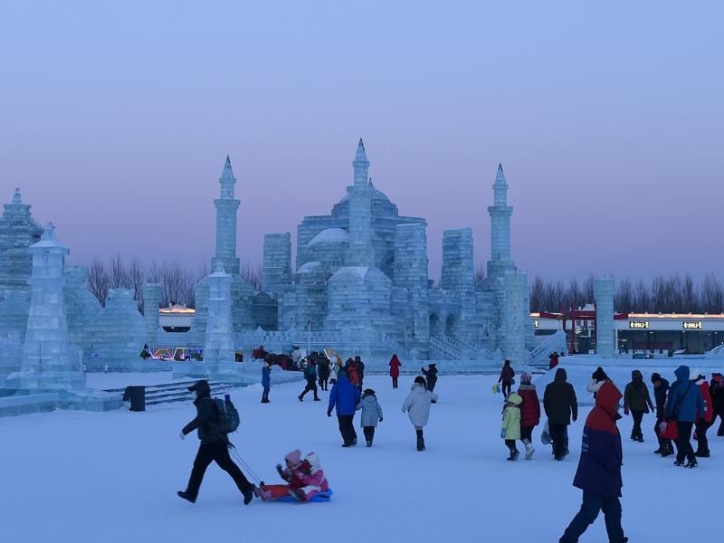 People visit the China Ice and Snow World on the eve of the opening ceremony. (AFP)