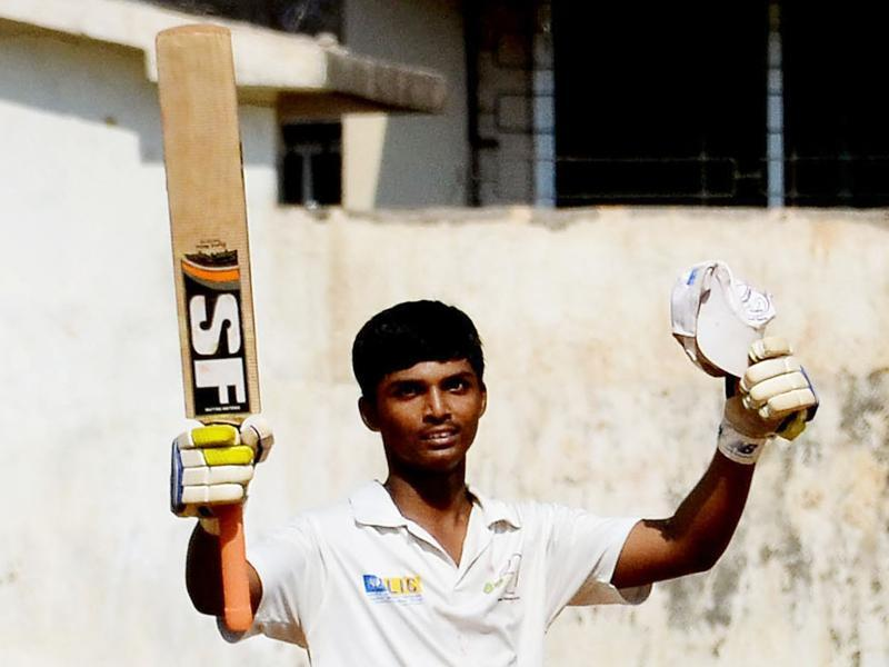 Mumbai teenager Pranav Dhanawade celebrates after smashing an unbeaten knock of 1,009 in an inter-school tournament, in Kalyan. (HT photo)