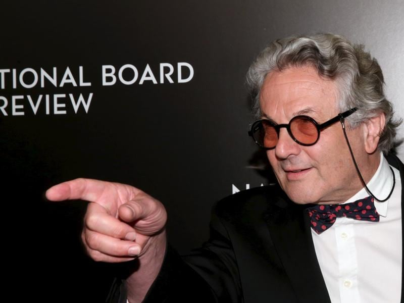 Mad Max: Fury Road director George Miller gestures to the photographers at The National Board of Review Gala in New York. (REUTERS)