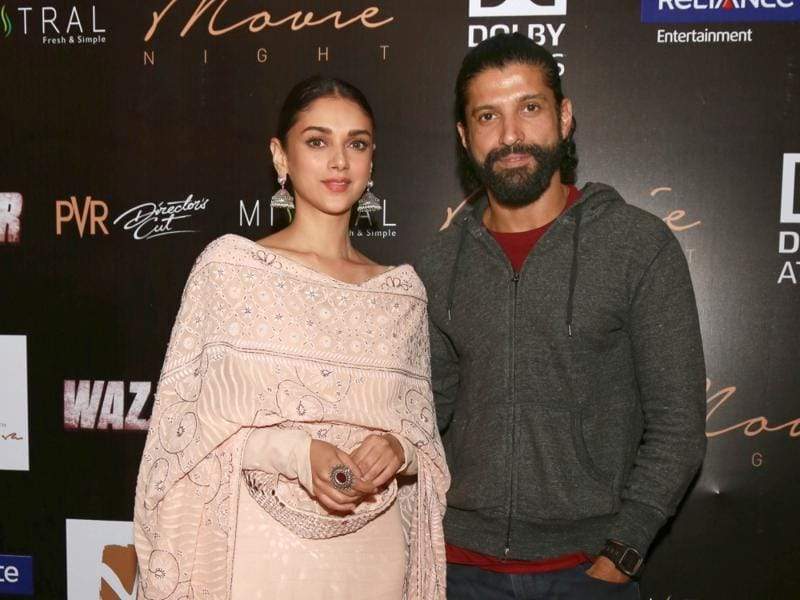 Farhan Akhtar and Aditi Rao Hydari pose for the shutterbugs as they promote Wazir in New Delhi.  (IANS)