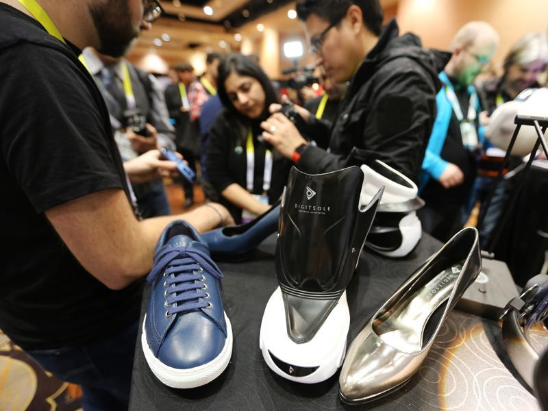 The Digisole smart shoes are controlled by a smartphone app for various actions such as automatic shoe tightening, foot warming, shock absorption measuring and even calories burnt. (AFP)