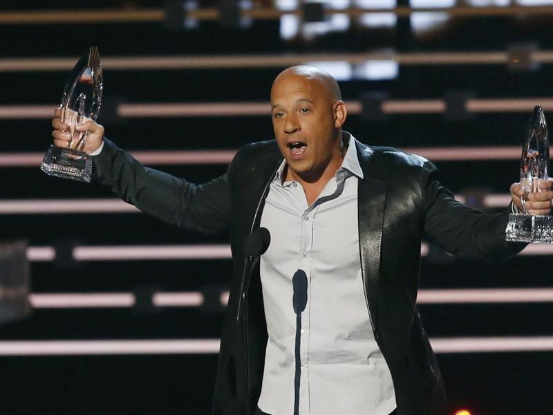 Actor Vin Diesel accepts the award for favourite movie and for favourite action movie for Furious 7 at the People's Choice Awards 2016 in Los Angeles. (REUTERS)