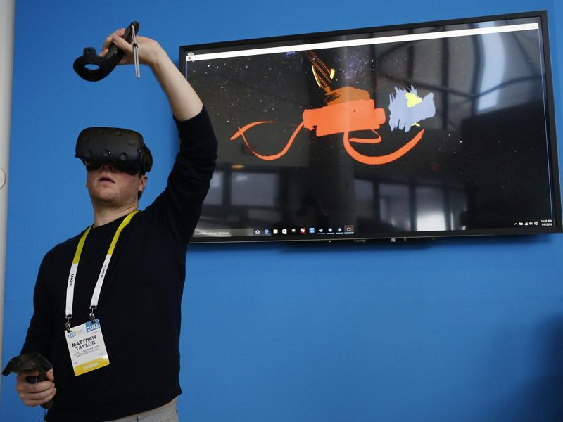 HTC Vive's virtual reality goggles work with Steam so that you can literally be in the game. (AP)