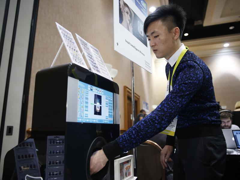 Inail Intelligent Printer prints directly on finger and toenails as well as fake nails. (AP)