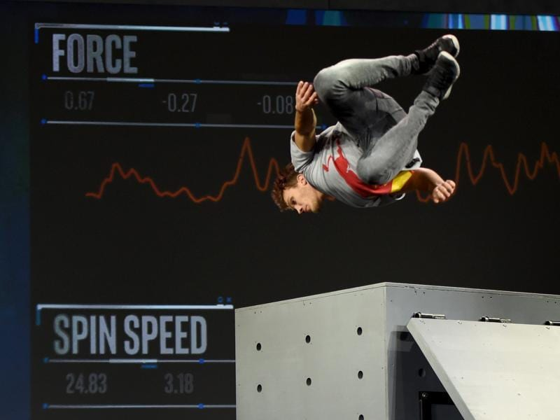 Intel's wearables' abilities range from making music out of gestures, to recording data from Professional free runner Jason Paul performs that include twisting jump off an obstacle in real time. No extra time waiting for wheel to turn and data to be crunched. (AFP)