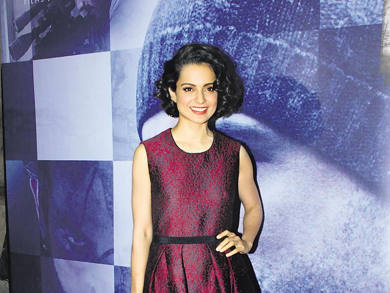 Kangana Ranaut strikes a pose at the special screening of Wazir in Mumbai. (photos: shakti yadav)