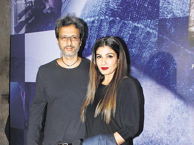 Raveena Tandon poses with husband Anil Thadani at the special screening of Wazir. (photos: shakti yadav)