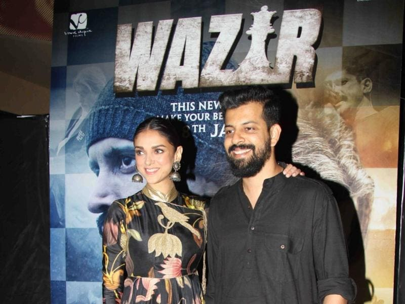 Director Bejoy Nambiar and Aditi Rao Hydari during the special screening of Wazir.  (IANS)