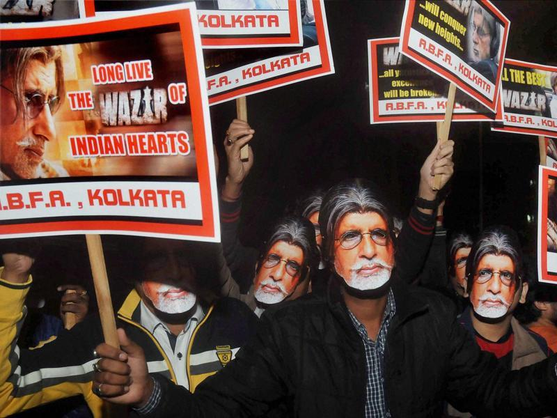 Fans of Amitabh Bachchan wearing his masks to celebrate during the special screening of Wazir in Kolkata on Thursday. (PTI)