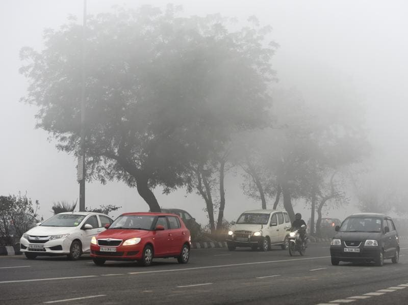 Met officials said the dense fog was due to a combination of high humidity and low wind speed. (Sushil Kumar/HT photo)