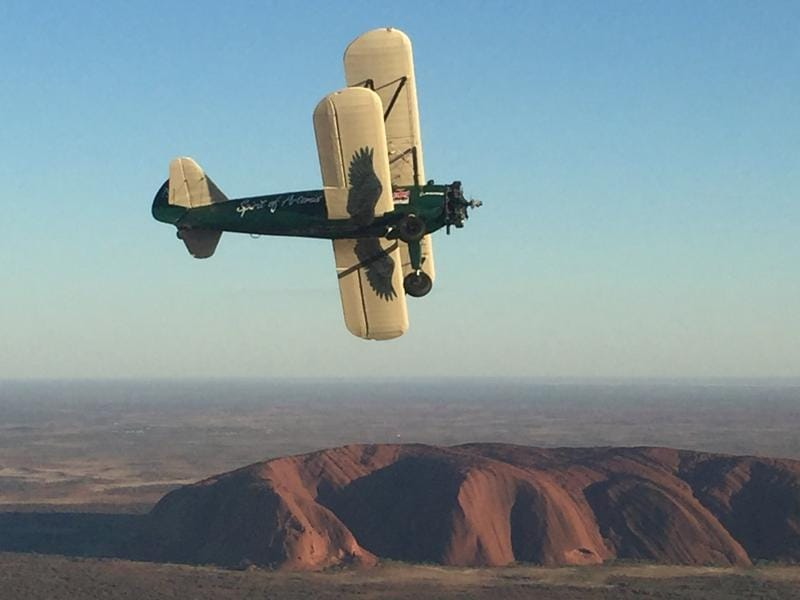 Spirit of Artemis, the vintage biplane over Australia's Uluru rock formation. (REUTERS)