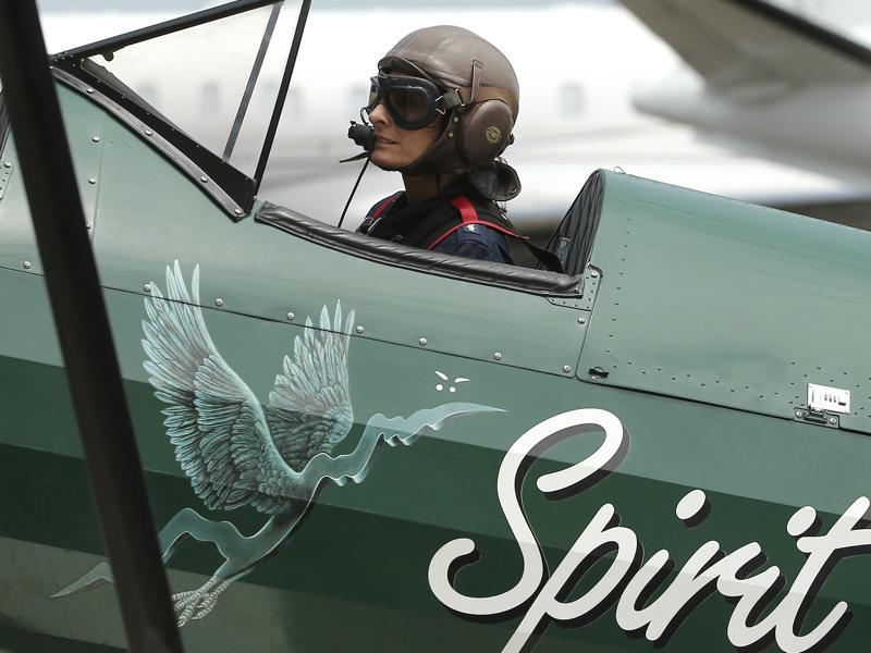British aviator Tracey Curtis-Taylor taxies her 1942 Boeing Stearman Spirit of Artemis aircraft after she arrived at Sydney Airport in Sydney, Australia, on Saturday.  (AP)
