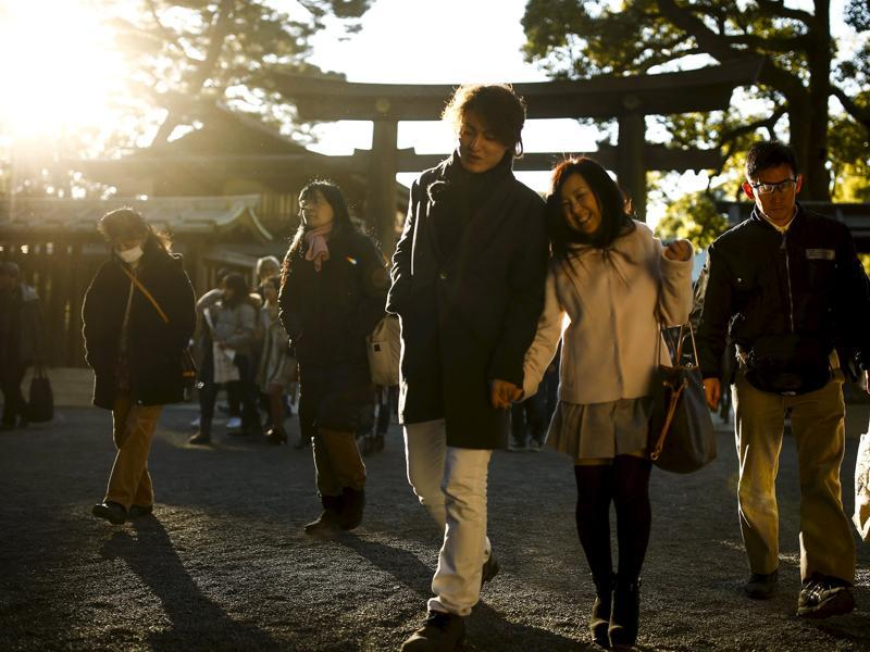 People leave the Shinto Meiji Shrine after New Year prayers in Tokyo. (REUTERS)