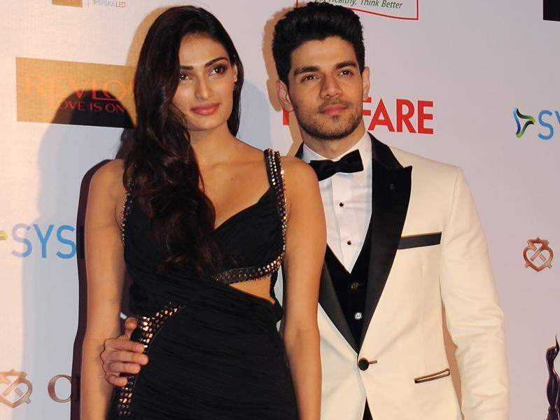The new generation of Bollywood -- Athiya Shetty and Suraj Pancholi -- oblige shutterbugs at the pre-awards   party.  (AFP)