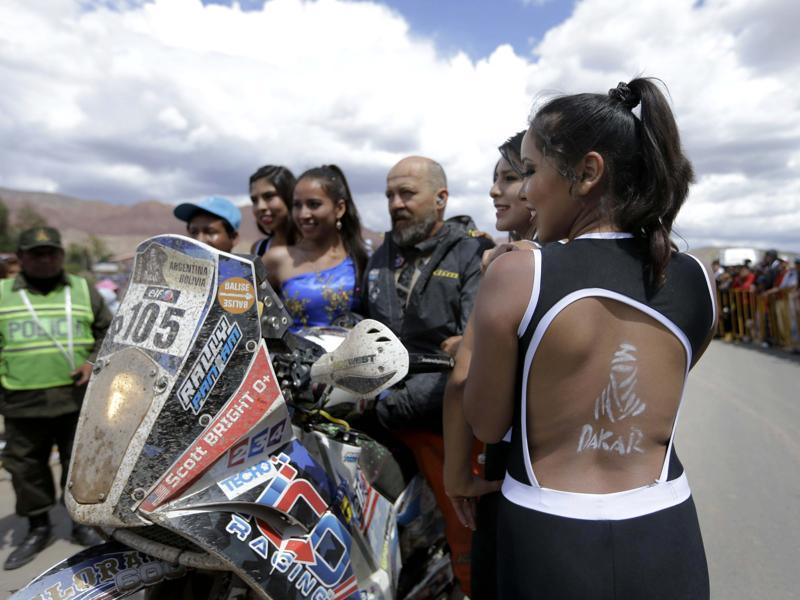 KTM rider Scott Bright of the U.S., poses for a picture with fans during the 7th stage of the 2016 Dakar Rally, in the Bolivian town of Tupiza, between Uyuni, Bolivia and Salta, Argentina. (AP Photo/Jorge Saenz)