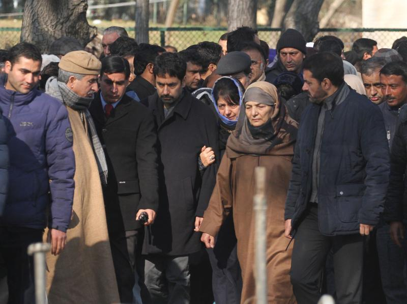 PDP president and daughter of Mufti Mohammad Sayeed arrives along with her brother and mother to offer prayers on the grave of her father in Dara Shikoh park in south Kashmir's Bijbehara town on Sunday. (Waseem Andrabi/HT Photo)