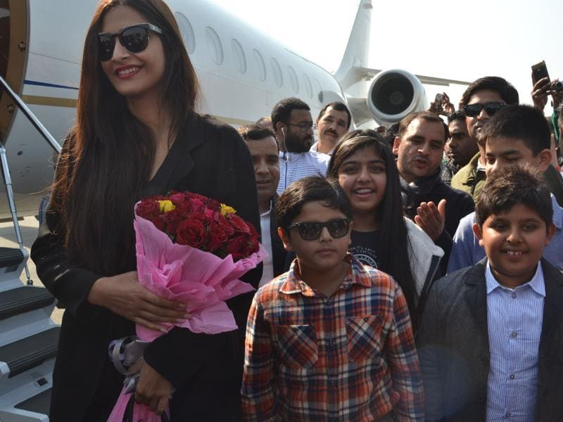 Actor Sonam Kapoor arrives in Saifai on Monday to attend the Ranvir Singh Memorial Saifai Mahostav, Uttar Pradesh's biggest rural festival.  (HT Photo)