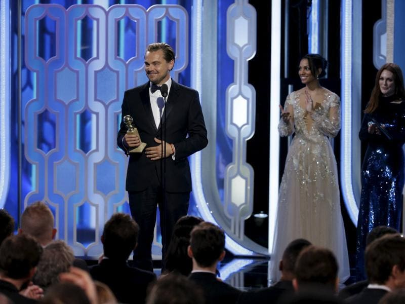 Leonardo DiCaprio holds his award for Best Actor, Motion Picture, Drama, for The Revenant, at the 73rd Golden Globe Awards in Beverly Hills, California January 10, 2016.  (REUTERS)