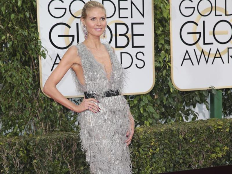 How do you make a supermodel like Heidi Klum look bad at the red carpet? By making her wear a terrible dress and adding a horrible belt to it. (AP)