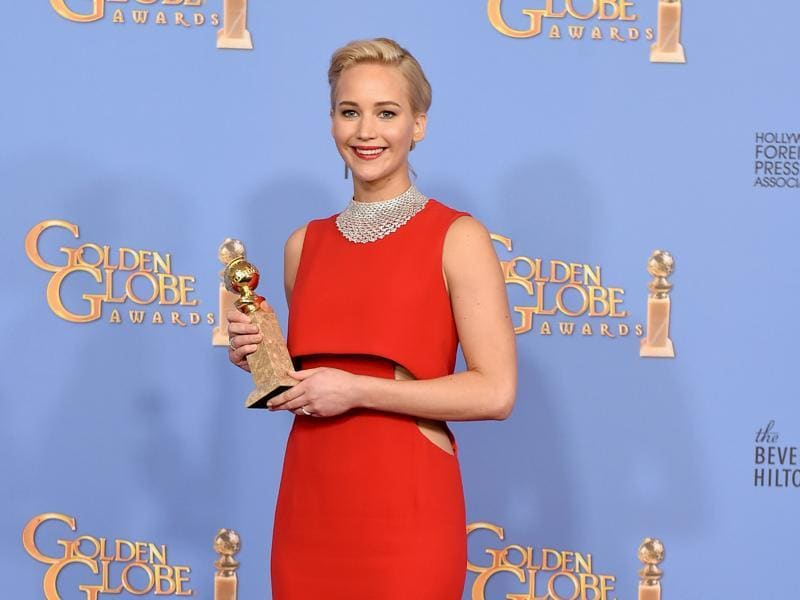 Jennifer Lawrence poses with the award for best performance by an actress in a motion picture - musical or comedy for Joy at the 73rd annual Golden Globe Awards on Sunday, Jan. 10, 2016, at the Beverly Hilton Hotel in Beverly Hills, Calif.  (AP)