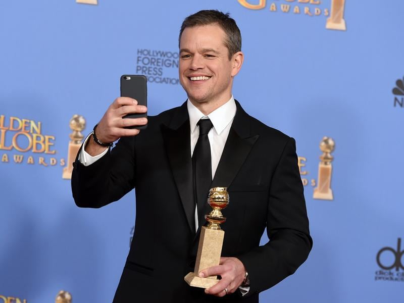 Matt Damon poses in the press room with the award for best performance by an actor in a motion picture - musical or comedy for The Martian at the 73rd annual Golden Globe Awards on Sunday, Jan. 10, 2016, at the Beverly Hilton Hotel in Beverly Hills, Calif.  (AP)
