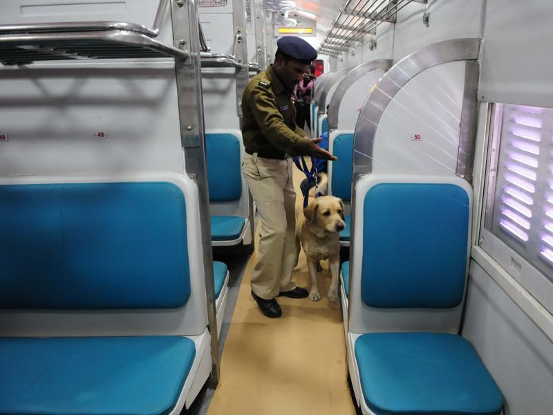 A sniffer dog checks the model coach before inspection by the Railways Board chairman AK Mittal, at the Habibganj railway station. (Mujeeb Faruqui/HT Photo)