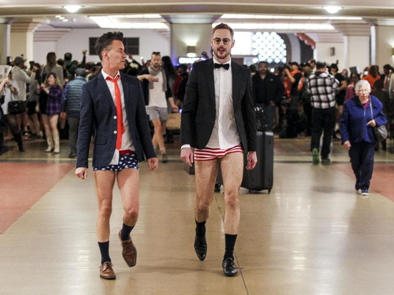 Scotland Beaver, left, and Mathew Spencer in the annual 'No Pants Metro Ride' walk in the Union Station. (AP)