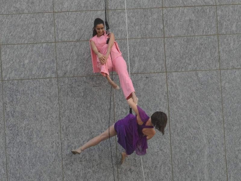 Shraddha Kapoor is quite at home as she performs a gravity-defying stunt during an event. (IANS)