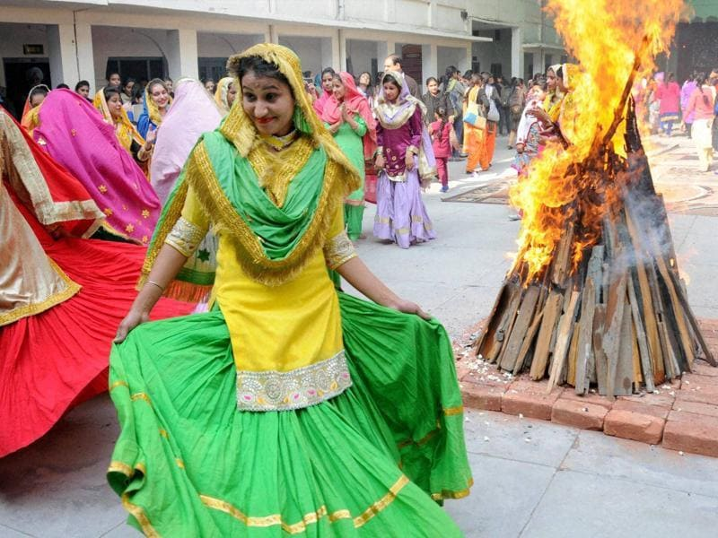 Lighting of bonfire is a key part of the Lohri tradition and signifies the return of longer days.  It is celebrated a day before Maghi. (PTI)