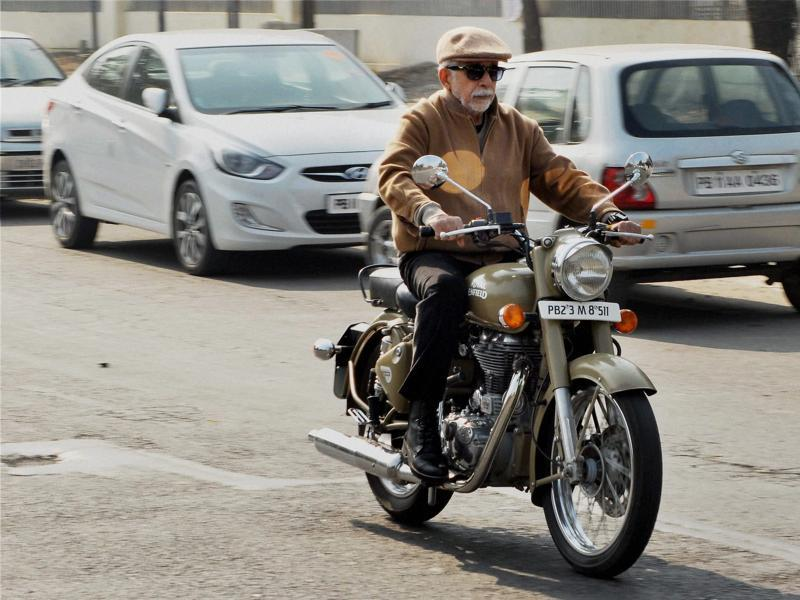 Naseeruddin Shah rides a Bullet motorcycle during shooting of upcoming film Irada in Patiala on Tuesday.  (PTI)