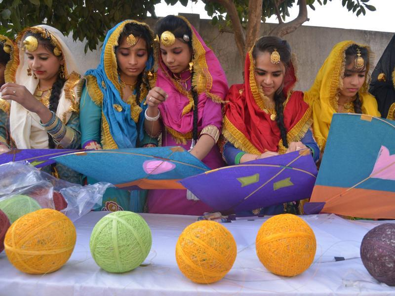 School girls prepare to fly kites during Lohri celebrations in Amritsar on Wednesday.  (AFP)