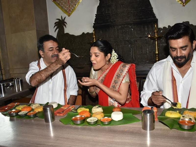 Boxer-turned-actor Ritika Singh enjoys the Pongal-special food with filmmaker Rajkumar Hirani and actor  R Madhavan. (UTV MOtion Pictures)