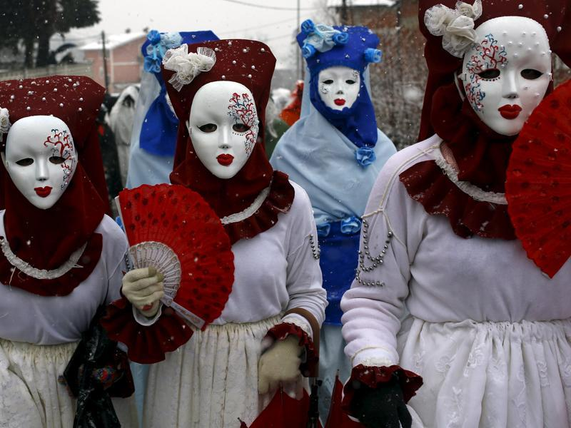 Revellers participate in a parade on the street during a carnival in Vevcani, Macedonia, January 13, 2016. Vevcani village marks the annual Orthodox St. Vasilij (Basil) Day with a carnival that features a 1,400-year-old celebration with pagan roots. (REUTERS)