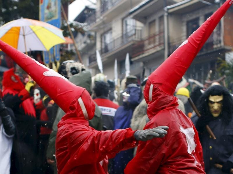 Revellers participate in a parade on the street during a carnival in Vevcani. (REUTERS)