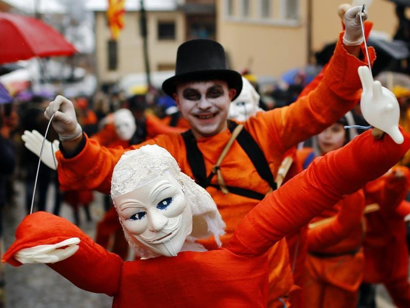 The highlights include a political satire where masked villagers act out current events. It is one of the most famous village festivals in the Balkans. Revellers participate in a parade on the street during Vevcani carnival. (REUTERS)