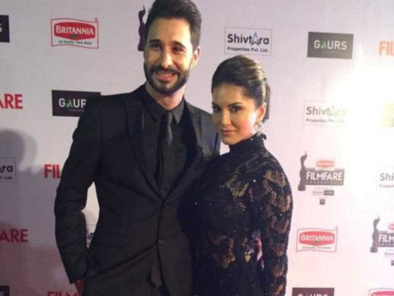 Lady in black: Sunny Leone with her husband Daniel Weber. (Twitter/Filmfare)