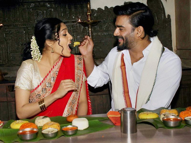 Actor R Madhavan and kick-boxer-turned actor Ritika Singh during a traditional Pongal breakfast while also promoting their film