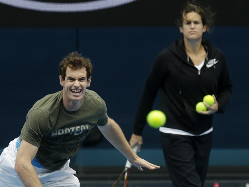 Britain's Andy Murray serves as his coach Amelie Mauresmo watches. (AP Photo)