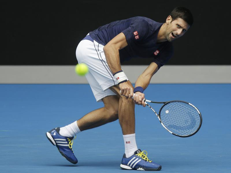 Serbia's Novak Djokovic makes a backhand return during a practice session ahead of the start of the Australian Open in Melbourne on January 15, 2016. The Australian Open begins on January 18. (AP Photo)