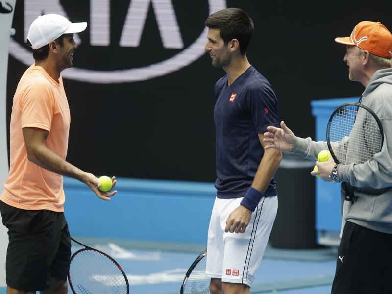 Spain's Fernando Verdasco, left, jokes with Djokovic and Boris Becker, right, during a practice session ahead of the start of the Australian Open. (AP Photo)