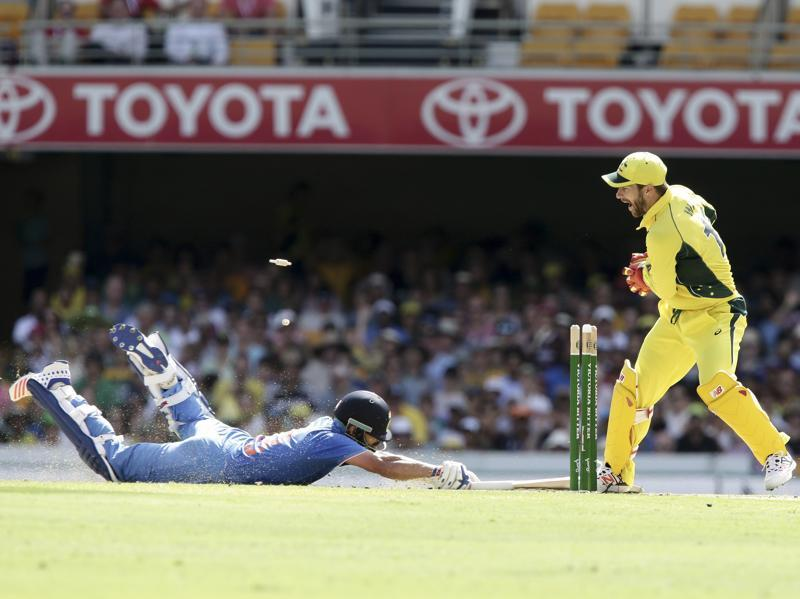 Virat Kohli, left, is run out by Australia's Matthew Wade. (AP Photo)