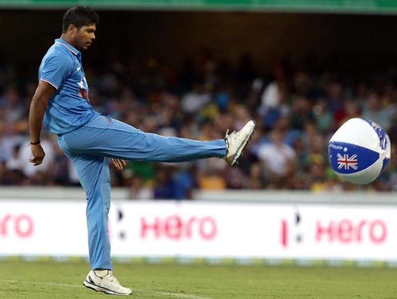 India's Umesh Yadav kicks a beach ball off the field of play. (AP Photo)
