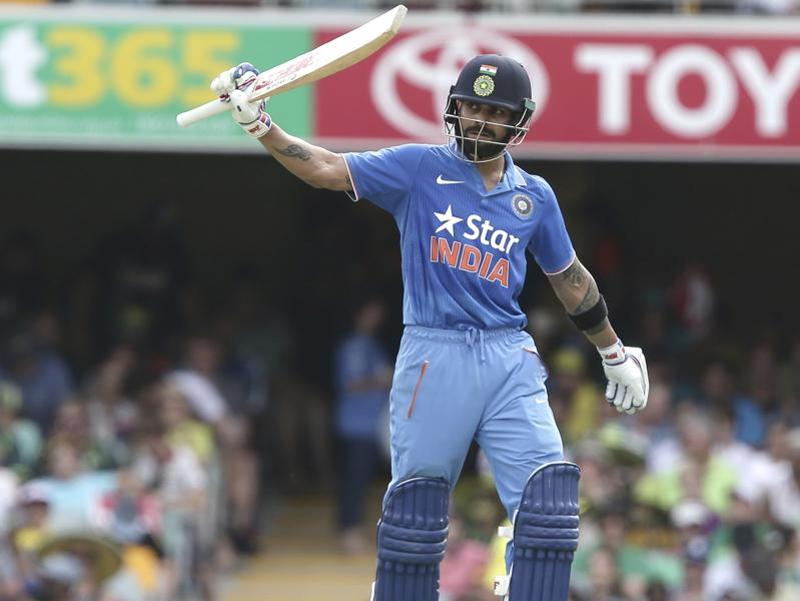Virat Kohli raises his bat after reaching 50 runs. (AP Photo)