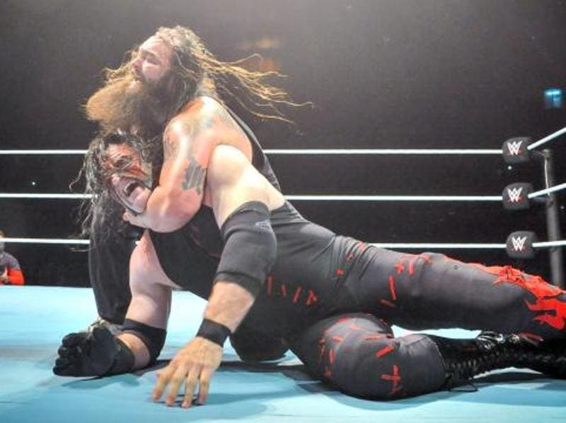 An intense encounter between Demon Kane and Bray Wyatt. (Photo: WWE.com)