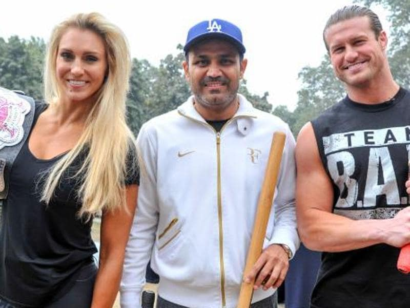 WWE superstars Dolph Ziggler and Charlotte played cricket with former Indian cricketer Virender Sehwag.  (Photo: WWE.com)