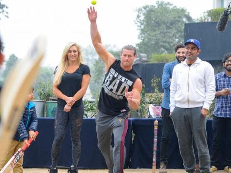 WWE superstars Dolph Ziggler and Charlotte tried their hand in cricker with VirenderSehwag.  (Photo: WWE.com)
